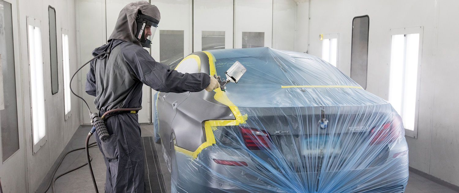 Paint finishing a car by AutoService Man